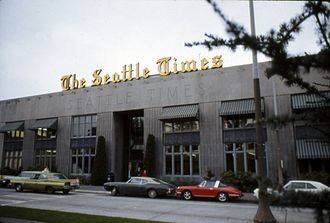 Seattle Times Building - The Times Building facing John Street in the 1970s, featuring the golden Times logo installed in 1947