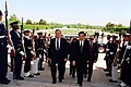 Secretary of Defense Donald H. Rumsfeld (left) escorts Vice President Hu Jintao, of China, through an honor cordon and into the Pentagon on May 1, 2002.jpg