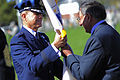 Secretary of Defense Leon E. Panetta, right, hands the U.S. Transportation Command flag to Air Force Gen. William M. Fraser III after Fraser assumed leadership of the command from Gen. Duncan J. McNabb during 111014-F-RG147-528.jpg