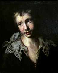 A boy in a lace collar.