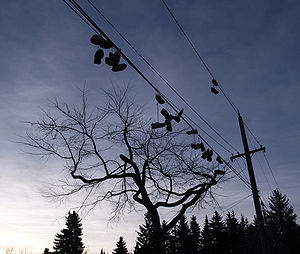 Shoes hanging on a power line near the Windsor...