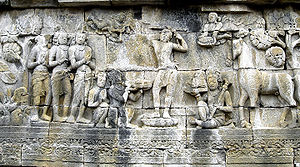 Buddhism in Southeast Asia - Prince Siddhartha shaves his hair and becomes an ascetic. Borobudur bas-relief, 9th century.
