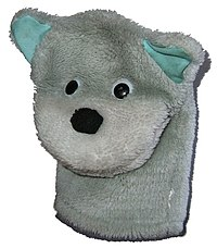 Simple toy dog hand puppet.