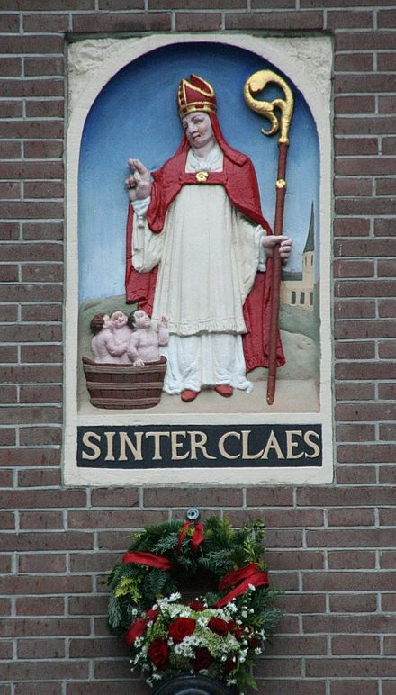Sinter Claes depiction at a 16th-century house near the Dam in Amsterdam. Saint Nicholas is the patron saint of the capital of the Netherlands Sinter-claes-saint-nicolas-dam800.jpg