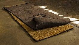 Sleeping mat and blanket at Robben Island maximum security prison.jpg