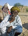 Smoking man with a turban, Rajasthan (6376106303).jpg