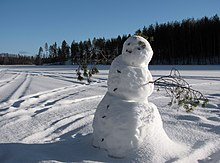 Photograph of a snowman on frozen Lake Saimaa, Puumala, Finland