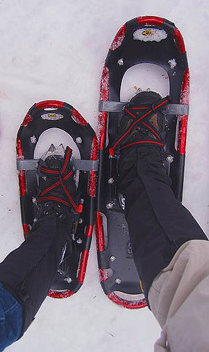 Properly adjusted bindings on two snowshoes of different size. Note use of gaiters. Snowshoes and bindings.jpg