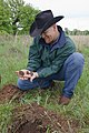 Soil scientist Nathan Haile examines soil health in well managed rangeland. (25111793895).jpg