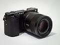 Sony Alpha ILCE-6000 APS-C-frame camera with lens.jpeg