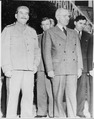 Soviet Prime Minister Josef Stalin poses with President Harry S. Truman during the Potsdam Conference in Germany. V.... - NARA - 198836.tif