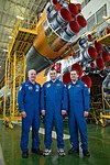 Soyuz TMA-20M crew in front of the Soyuz booster rocket.jpg