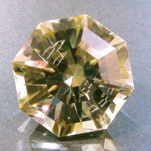 Facet - A faceted spodumene, with reflecting internal inclusion.