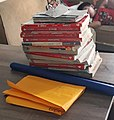 Stack of school books on top of a table.jpg