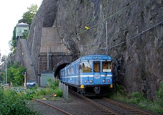 Saltsjöbanan - A train (C11) on Saltsjöbanan entering Stadsgården tunnel. At lower left is the former track towards Stockholm South, now paved over a few dozen metres from this point.