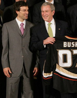 Scott Niedermayer - Niedermayer (left) presenting U.S. President George W. Bush with a Ducks jersey following their 2007 championship.