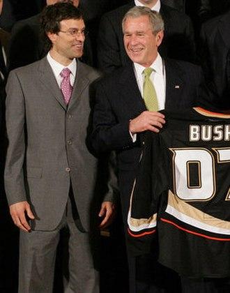 Scott Niedermayer - Niedermayer (left) presenting U.S. President George W. Bush with a Ducks jersey following their 2007 championship.