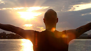 English: Photo of man Sungazing during sunrise...