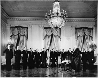 Timeline of the John F. Kennedy presidency - January 21:The Cabinet is sworn in by Chief Justice Earl Warren.