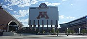 "Large sign saying ""M"", towering above a football field"