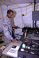 TSG Sgt. Jason Wilson programs land mobile radios during the 644th Combat Communications Squadron's Dragon Thunder exercise at Andersen AFB.jpg