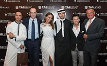 dina and husband omar butti posing for tag heuer celebrity club