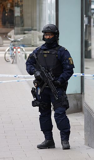 2017 Stockholm attack - Swedish police officer in tactical gear on patrol the day after the attack in Stockholm