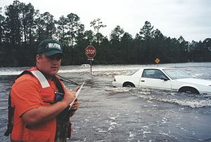 Mississippi Highway 15 - Water flowing over Old Hwy 67 and Mississippi Highway 15 near their intersection in Harrison County on September 29, 1998 during the September 1998 flooding caused on the Tchoutacabouffa River by Hurricane Georges.