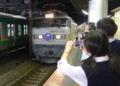 Tetsudo fan shooting a train.png