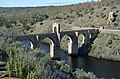 The Alcántara Bridge built over the Tagus River between 104 and 106 AD by a man named Caius Julius Lacer, and dedicated to the Roman emperor Trajan, Spain (38766037860).jpg