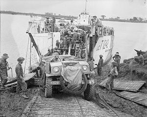 Operation Dracula - A 25-pdr field gun being bought ashore from a landing craft at Elephant Point, 2 May 1945