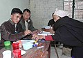 The Electoral official applying the indelible ink on an old lady voter at a polling booth in Kohima during Nagaland Assembly Election-2008, on March 05, 2008.jpg