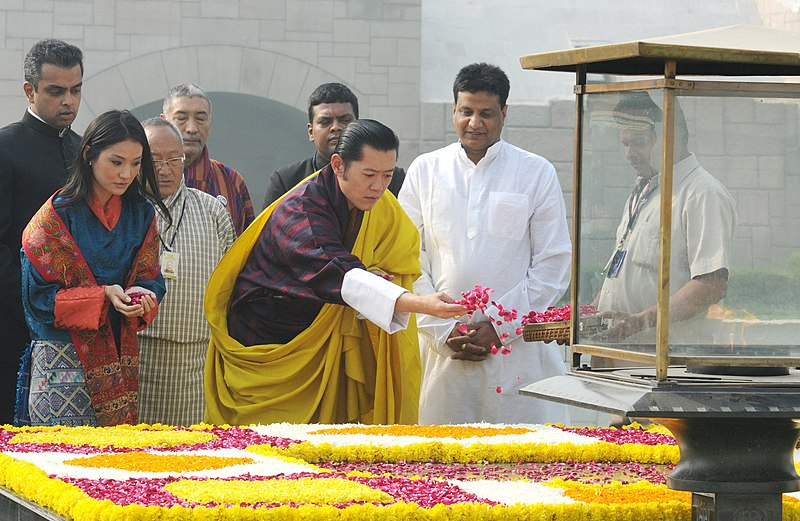 File:The King of Bhutan, His Majesty Jigme Khesar Namgyel Wangchuck and the Bhutan Queen, Her Majesty Jetsun Pema Wangchuck paying floral tributes at the Samadhi of Mahatma Gandhi, at Rajghat, in Delhi on October 24, 2011.jpg