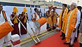 The Prime Minister, Shri Narendra Modi and the Prime Minister of Japan, Mr. Shinzo Abe being given traditional welcome, on their arrival at Varanasi, Uttar Pradesh on December 12, 2015.jpg