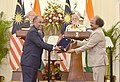 The Prime Minister, Shri Narendra Modi and the Prime Minister of Malaysia, Dato' Sri Mohd Najib Bin Tun Abdul Razak witnessing the exchange of agreements, at Hyderabad House, in New Delhi on April 01, 2017 (1).jpg
