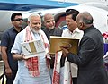 The Prime Minister, Shri Narendra Modi being welcomed by the Governor of Assam, Shri Banwarilal Purohit and the Chief Minister of Assam, Shri Sarbananda Sonowal on his arrival, in Dibrugarh, Assam on May 26, 2017 (2).jpg