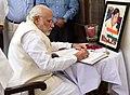 The Prime Minister, Shri Narendra Modi writing the obituary message for the former Lok Sabha Speaker, Shri P.A. Sangma, in New Delhi on March 04, 2016.jpg