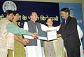 The Union Minister for Youth Affairs and Sports, Shri Sunil Dutt giving away the Special Awards to one of the Awardee who won medal in international sports events during the year 2004, in New Delhi on March 2, 2005.jpg