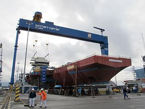 The forward island of the queen elizabeth class aircraft carrier being attached to the main body of the carrier.jpg