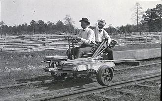 Handcar - 3-wheeled handcar or velocipede on a railroad track.