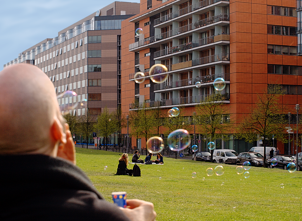 Blowing bubbles at Tilla-Durieux-Park near Potsdamer Platz, Berlin-Mitte