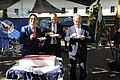 Timothy Eydelnant, Bernd Wiegand, and Reiner Haseloff eat some Independence Day Cake.jpg