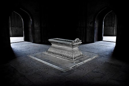 """Tomb of Safdarjung, New DelhiAuthor: Pranav Singh. Jury Comments """"The strong light contrast between the lighted tomb and the darkness of the room emphasizes the monument, and gives it a dramatic component. The tomb is sharp and detailed, and free of visual distractions; with gravity and a perfect sense for the angle of view and light this picture presents the object – the architecture and light forming a stage for the tomb, focusing on the details of the stone carving. All in all a nicely framed and executed picture that seems to speak of the significance of this tomb.""""    This is a photo of ASI monument number N-DL-50."""