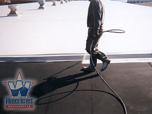 Roof coating - Top coating a commercial flat roof with a cool roof test