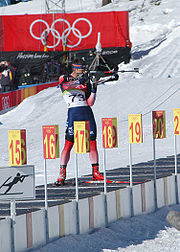 Jeremy Teela shoots from the standing position at the 2006 Winter Olympics.