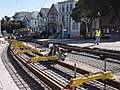 Track gauge setting during construction at Duboce and Noe, February 2012.jpg