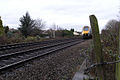 Train approaching foot level-crossing - geograph.org.uk - 628575.jpg