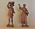 Two peasants in pine wood Gröden.jpg