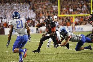 Shea McClellin - McClellin (far right) tackling Virginia Tech's quarterback Tyrod Taylor.