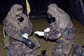 U.S. Air Force Airman 1st Class Octavio Valverde, left, and Airman 1st Class Andrew Monroe, both assigned to 314th Civil Engineering Squadron, put on MOPP 4 gear at Little Rock Air Force Base, Ark., April 26 070426-F-OD942-007.jpg